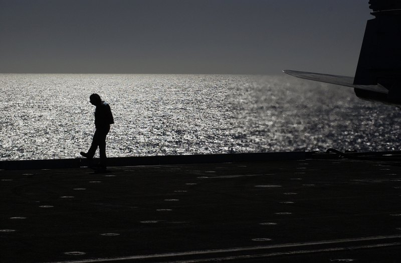 Waiting. Aboard the Aircraft Carrier USS Ronald Reagan (CVN 76), United States Navy, November 16, 2006. Pacific Ocean, State of California (Southern Area), USA. Photo Credit: Mass Communication Specialist 2nd Class Aaron Burden, Navy NewsStand – Eye on the Fleet Photo Gallery (http://www.news.navy.mil/view_photos.asp, 061116-N-7130B-071), United States Navy (USN, http://www.navy.mil), United States Department of Defense (DoD, http://www.DefenseLink.mil or http://www.dod.gov), Government of the United States of America (USA).