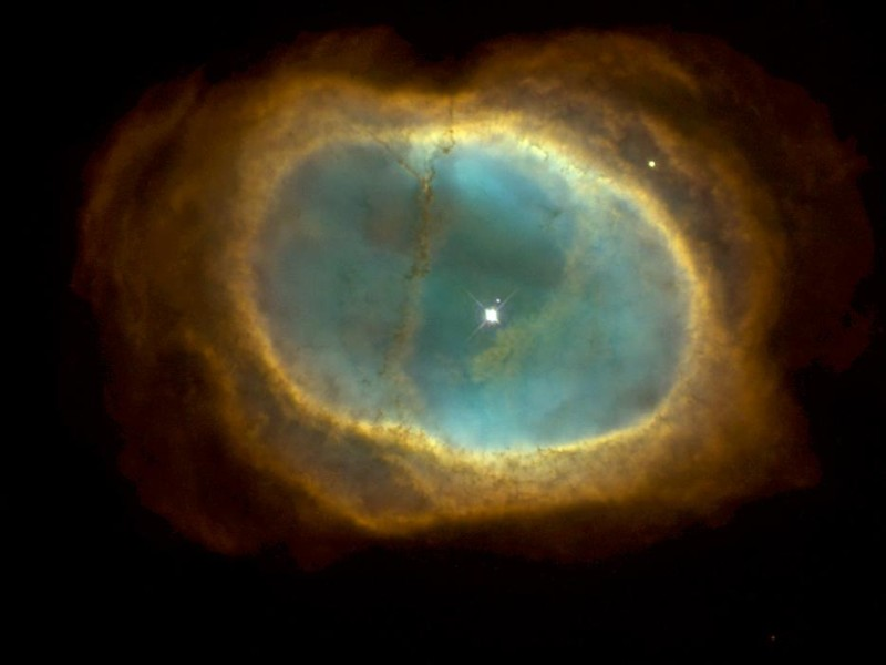 Planetary Nebula NGC 3132, Also Known As the 'Eight-Burst' Nebula or the 'Southern Ring' Nebula, Vela Constellation. Photo Credit: A Glowing Pool of Light: Planetary Nebula NGC 3132, (Release date: November 5, 1998), STScI-1998-39, NASA's Earth-orbiting Hubble Space Telescope (http://HubbleSite.org); The Hubble Heritage Team (STScI/AURA), National Aeronautics and Space Administration (NASA, http://www.nasa.gov), Government of the United States of America (USA).