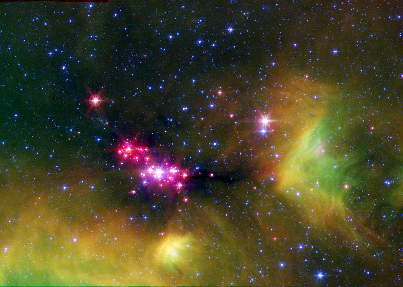 Infrared, False-color View of the Glowing Stars of Serpens Cluster A, Constellation Serpens. Photo Credit: Seeing Stars in Serpens, sig06-026, April 5th, 2004 (IRAC) and April 6th, 2004 (MIPS) (Release date: October 24, 2006), NASA's Spitzer Space Telescope (http://www.spitzer.caltech.edu); NASA/JPL-Caltech/Lucas Cieza (University of Texas at Austin), National Aeronautics and Space Administration (NASA, http://www.nasa.gov), Government of the United States of America (USA).
