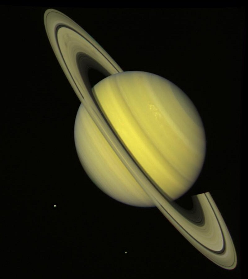 Beautiful and Majestic Saturn, a Planet In Our Solar System, With Rhea and Dione, Two of Its Many Satellites (Moons). Photo Credit: Voyager Mission (http://voyager.jpl.nasa.gov), Voyager 2, July 21, 1981; Planetary Photojournal (http://photojournal.jpl.nasa.gov, PIA00030), National Aeronautics and Space Administration (NASA, http://www.nasa.gov)/Jet Propulsion Laboratory (JPL, http://www.jpl.nasa.gov), Government of the United States of America.