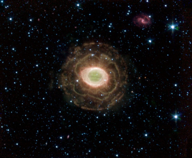 Ring Nebula -- Messier Object 57 or NGC 6720 in the Constellation Lyra. Photo Credit: Spitzer Space Telescope (SST, http://www.spitzer.caltech.edu/spitzer/); Planetary Photojournal (http://photojournal.jpl.nasa.gov, PIA07343:), Harvard-Smithsonian CfA and National Aeronautics and Space Administration (NASA, http://www.nasa.gov)/Jet Propulsion Laboratory-Caltech (JPL, http://www.jpl.nasa.gov), Government of the United States of America.