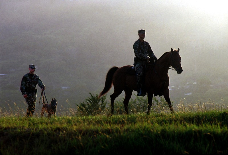 Guarding and Patrolling the Perimeter on Foot and Horseback, November 1999, Howard Air Force Base, Republica de Panama - Republic of Panama. Photo Credit: SSgt. Gary Coppage, United States Air Force; Defense Visual Information Center (DVIC, http://www.DoDMedia.osd.mil, DFSD0108694 and 991101F3500C007) and United States Air Force (USAF, http://www.af.mil), United States Department of Defense (DoD, http://www.DefenseLink.mil or http://www.dod.gov), Government of the United States of America (USA).