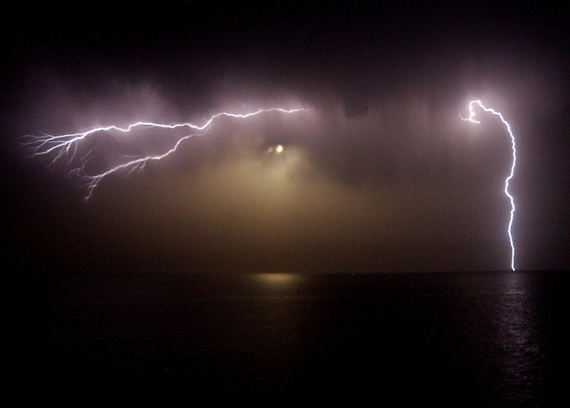 Lightning Bolts (Flashes) at Night as Seen From the Signal Bridge Aboard the United States Navy Aircraft Carrier USS George Washington (CVN 73), May 4, 2004, Arabian Gulf. Photo Credit: Photographer's Mate 3rd Class Lindsay Switzer, Navy NewsStand - Eye on the Fleet Photo Gallery (http://www.news.navy.mil/view_photos.asp, 040504-N-1280S-006), United States Navy (USN, http://www.navy.mil), United States Department of Defense (DoD, http://www.DefenseLink.mil or http://www.dod.gov), Government of the United States of America (USA).