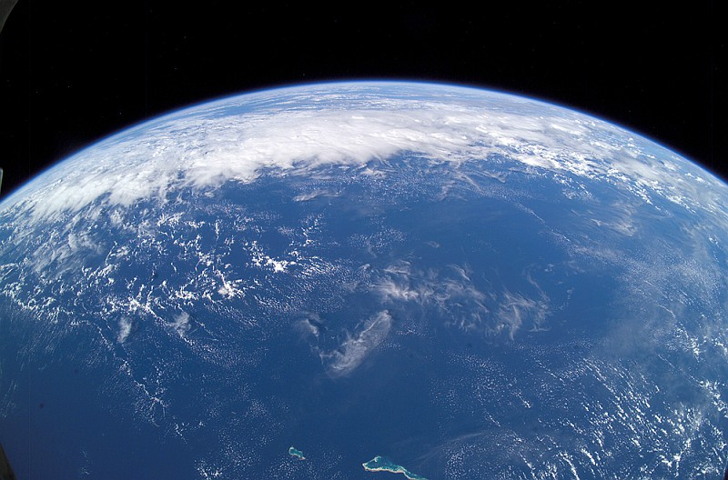 Beautiful Planet Earth, Our Home, As Seen From the International Space Station on June 13, 2003. Photo Credit: ISS007-E-7304, Earth, Pan-Clouds, Pacific Ocean, Republic of Kiribati islands (atolls) in the foreground: Tabiteuea and Onotoa; Image Science and Analysis Laboratory, NASA-Johnson Space Center. 10 July 2006. 'Astronaut Photography of Earth - Display Record.' <http://eol.jsc.nasa.gov/scripts/sseop/photo.pl?mission=ISS007&roll=E&frame=7304>; National Aeronautics and Space Administration (NASA, http://www.nasa.gov), Government of the United States of America (USA).
