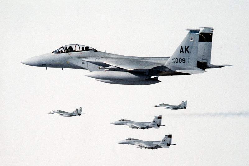2. Three (3) Visible United States Air Force F-15 Eagle Fighter Jets, Assigned to 21st Tactical Fighter Wing, Escort Two (2) Soviet MiG-29 Fighter Aircraft to Elmendorf Air Force Base For Refueling, August 1989, State of Alaska, USA. Photo Credit: Sgt. Gregory A. Suhay, United States Air Force (USAF, http://www.af.mil); Defense Visual Information Center (DVIC, http://www.DoDMedia.osd.mil, DFST9005774) and United States Air Force (USAF, http://www.af.mil), United States Department of Defense (DoD, http://www.DefenseLink.mil or http://www.dod.gov), Government of the United States of America (USA).
