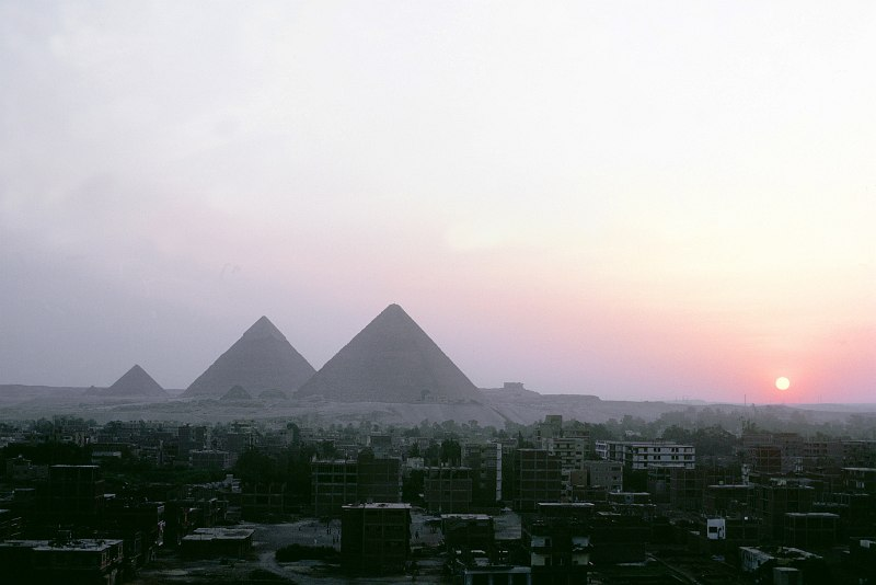 2. Sunset and a View of One of the Seven Wonders of the World, the Great Pyramids, Cairo, Jumhuriyat Misr al-Arabiyah - Arab Republic of Egypt. Photo Credit: DoD Stock Photos; Defense Visual Information Center (DVIC, http://www.DoDMedia.osd.mil, DFST9905291), United States Department of Defense (DoD, http://www.DefenseLink.mil or http://www.dod.gov), Government of the United States of America (USA).