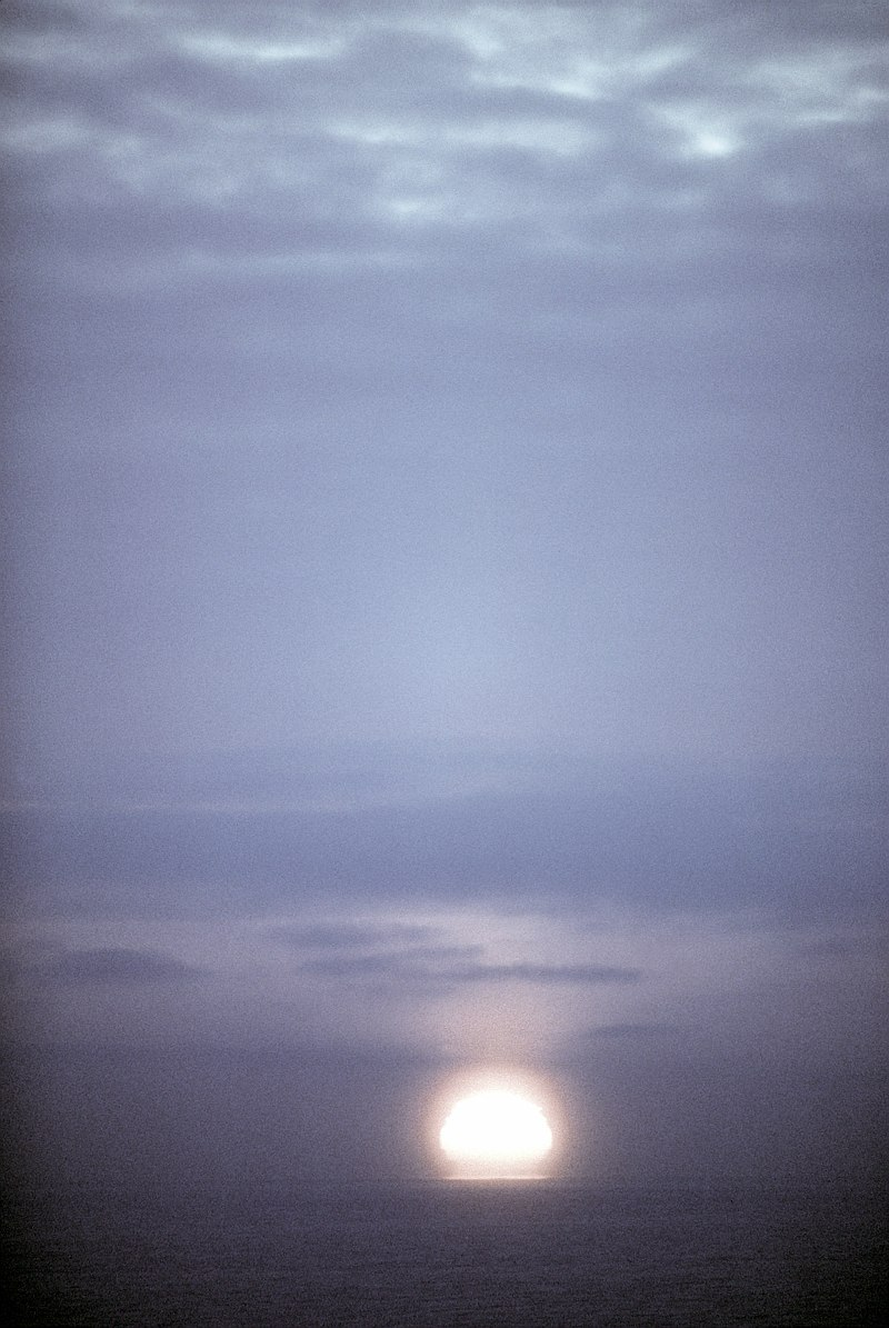 6. Sunset, March 8, 1982, Kotzebue Air Station, State of Alaska, USA. Photo Credit: Staff Sgt. Bill Thompson; Defense Visual Information Center (DVIC, http://www.DoDMedia.osd.mil, DFST8300332), United States Department of Defense (DoD, http://www.DefenseLink.mil or http://www.dod.gov), Government of the United States of America (USA).