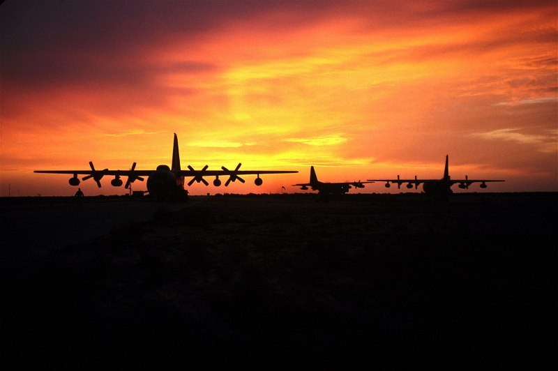 7. Sunset, June 1, 1999, Ali Al Salem Air Base, Dawlat al Kuwayt - State of Kuwait. Photo Credit: Senior Master Sergeant (SMSGT) Rose Reynolds, United States Air Force (USAF, http://www.af.mil); Defense Visual Information Center (DVIC, http://www.DoDMedia.osd.mil, DFSD0207485 and 990601-F-6300R-020) and United States Air Force (USAF, http://www.af.mil), United States Department of Defense (DoD, http://www.DefenseLink.mil or http://www.dod.gov), Government of the United States of America (USA).