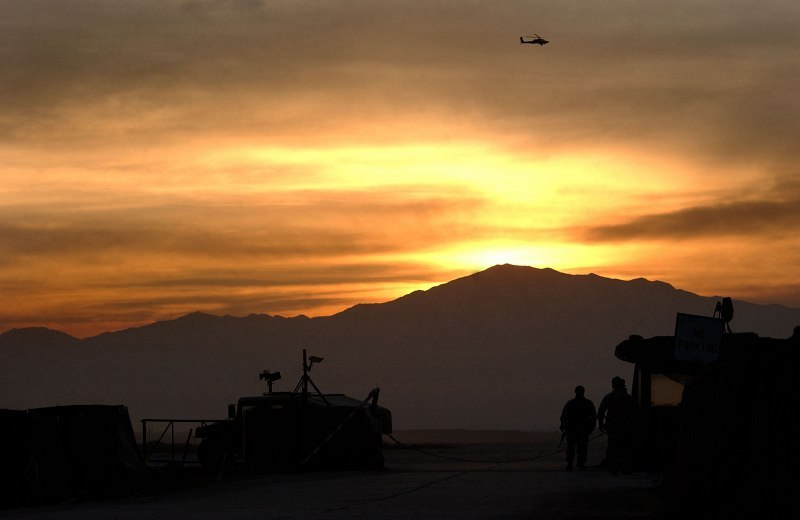 8. Sunrise Over Bagram Air Base, January 15, 2003, Parvan Province, Jomhuri-ye Eslami-ye Afghanestan - Islamic Republic of Afghanistan. Photo Credit: Staff Sgt. Cherie A. Thurlby, 1st Combat Camera, 1 CTCS Deployed, United States Air Force (USAF, http://www.af.mil); Defense Visual Information Center (DVIC, http://www.DoDMedia.osd.mil, DFSD0413828 and 030115F7203T001) and United States Air Force (USAF, http://www.af.mil), United States Department of Defense (DoD, http://www.DefenseLink.mil or http://www.dod.gov), Government of the United States of America (USA).