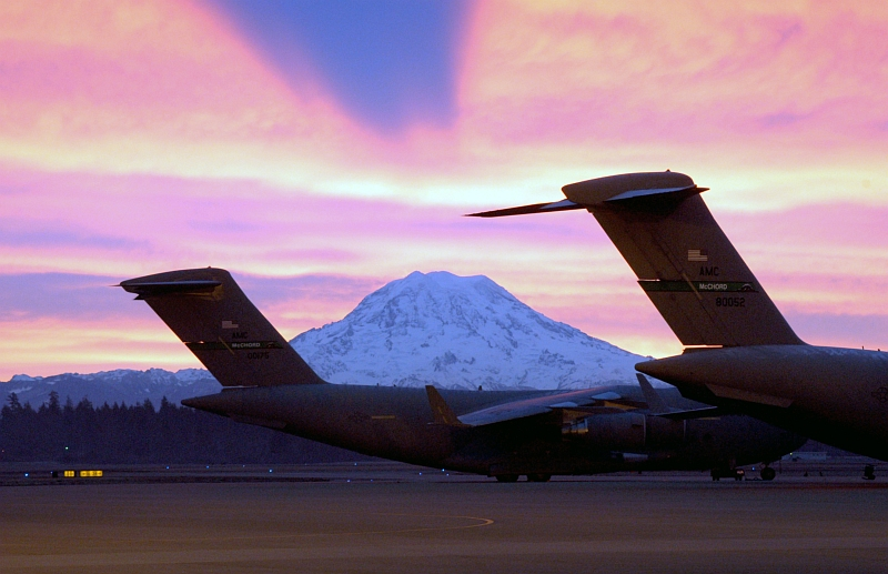 9. The Sunrise Over Mount Rainier Casts a Shadow of the Mountain On the Clouds Above, December 30, 2003, McChord Air Force Base, State of Washington, USA. Photo Credit: Kevin J. Tosh, CIV, United States Air Force (USAF, http://www.af.mil); Defense Visual Information Center (DVIC, http://www.DoDMedia.osd.mil, DFSD0602890 and 031230F0158T001) and United States Air Force (USAF, http://www.af.mil), United States Department of Defense (DoD, http://www.DefenseLink.mil or http://www.dod.gov), Government of the United States of America (USA).