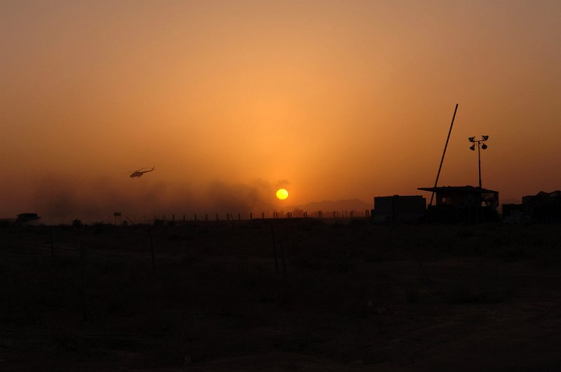 26. Sunrise at Kandahar Airfield, September 15, 2005, Jomhuri-ye Eslami-ye Afghanestan - Islamic Republic of Afghanistan. Photo Credit: Sgt. Andre Reynolds, United States Air Force (USAF, http://www.af.mil); Defense Visual Information Center (DVIC, http://www.DoDMedia.osd.mil, DASD0604000 and 050915A5679R001) and United States Air Force (USAF, http://www.af.mil), United States Department of Defense (DoD, http://www.DefenseLink.mil or http://www.dod.gov), Government of the United States of America (USA).