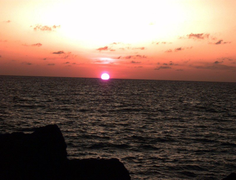 31. In This Lovely Sunrise, the Sun Appears to Rise From Beneath the Indian Ocean, December 24, 1992, Off the coast of Kismayo, Jamhuuriyada Demuqraadiga Soomaaliyeed - Somalia. Photo Credit: Sgt. Dan Hart; Defense Visual Information Center (DVIC, http://www.DoDMedia.osd.mil, DASD9702545 and J3301DSP92000010), United States Department of Defense (DoD, http://www.DefenseLink.mil or http://www.dod.gov), Government of the United States of America (USA).