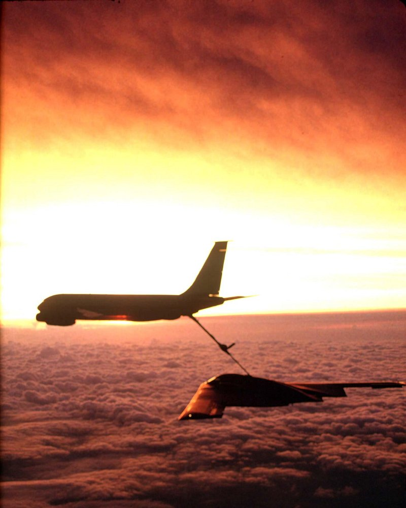 "33. A Sunset -- A Dazzlingly Bright Wall of Light, Brilliantly Painted In White and Yellow and Orange Hues (Colors) -- Above the Clouds, December 2, 2002. Photo Credit: Senior Master Sergeant (SMSgt.) Rose Reynolds, Air Force Link - Photos (http://www.af.mil/photos, 030202-F-0193C-004, ""Sunset refueling""), United States Air Force (USAF, http://www.af.mil), United States Department of Defense (DoD, http://www.DefenseLink.mil or http://www.dod.gov), Government of the United States of America (USA)."