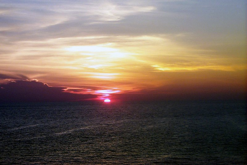 35. The Sun Sinks Below the Horizon, May 8, 2000, Philippine Sea. Photo Credit: Captain Kristen A. Lasica, United States Marine Corps (USMC, http://www.usmc.mil); Defense Visual Information Center (DVIC, http://www.DoDMedia.osd.mil, DMSD0305906 and 000508M6906L005) and United States Marine Corps (USMC, http://www.usmc.mil), United States Department of Defense (DoD, http://www.DefenseLink.mil or http://www.dod.gov), Government of the United States of America (USA).