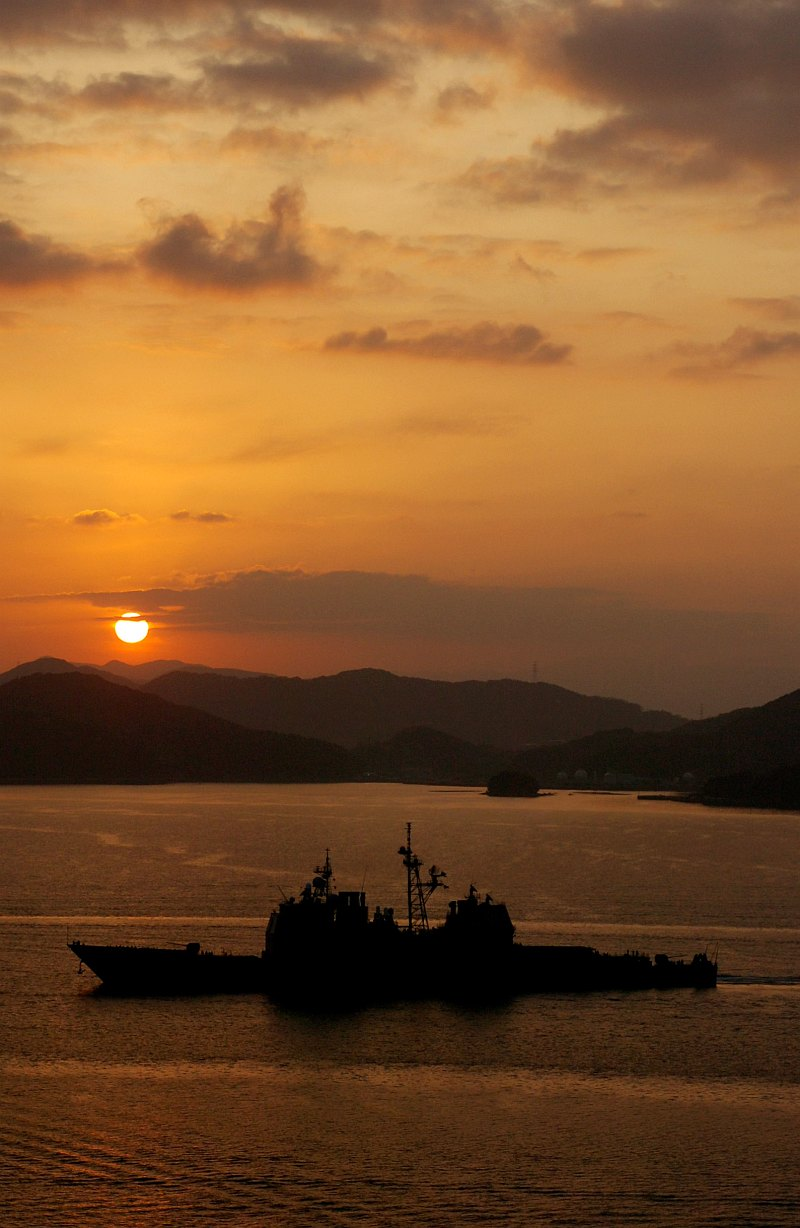38. Sol -- Earth's Sun -- Rising or Setting Over the Mountains, February 24, 2007, Sasebo, Nippon-koku (Nihon-koku) - Japan. Photo Credit: Mass Communication Specialist 3rd Class Sarah Foster, Navy NewsStand - Eye on the Fleet Photo Gallery (http://www.news.navy.mil/view_photos.asp, 070224-N-7730F-001), United States Navy (USN, http://www.navy.mil), United States Department of Defense (DoD, http://www.DefenseLink.mil or http://www.dod.gov), Government of the United States of America (USA).