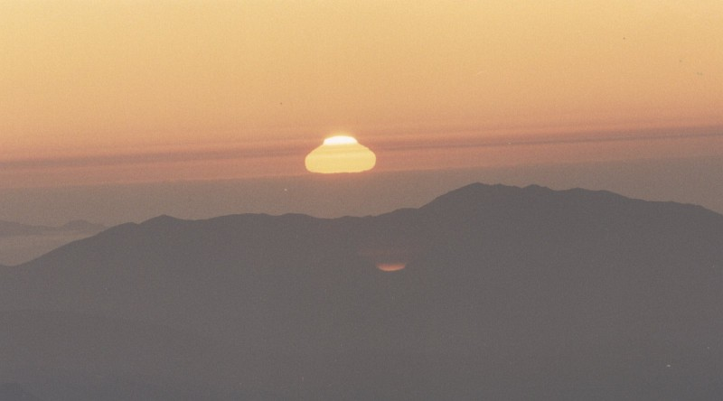 40. Sunset, Cerro Tololo, Republica de Chile - Republic of Chile. Photo Credit: CTIO (Cerro Tololo Inter-American Observatory, http://www.ctio.noao.edu) at night: Sunset at Cerro Tololo, Chile. Close to the horizon often anomal refractions distort the image of a rising and setting object (http://ad.usno.navy.mil/ucac/pic_night.html). United States Naval Observatory (USNO) CCD Astrograph Catalog (UCAC, http://ad.usno.navy.mil/ucac), Astrometry Department of the U.S. Naval Observatory (http://ad.usno.navy.mil), United States Navy (USN, http://www.navy.mil), United States Department of Defense (DoD, http://www.DefenseLink.mil or http://www.dod.gov), Government of the United States of America (USA).