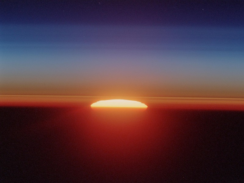 48. Sunset Over the Sahara Desert, June 18, 2002, As Seen Through Earth's Atmospheric Limb From Space Shuttle Endeavour (STS-111) While Over Sudan Near the Red Sea Coast. Photo Credit: STS111-321-24, Atmospheric limb, Sunset, Sahara Desert, Space Shuttle Endeavour (STS-111) over Sudan near the Red Sea coast; Image Science and Analysis Laboratory, NASA-Johnson Space Center. ' Astronaut Photography of Earth - Display Record.' <http://eol.jsc.nasa.gov/scripts/sseop/photo.pl?mission=STS111&roll=321&frame=24>; National Aeronautics and Space Administration (NASA, http://www.nasa.gov), Government of the United States of America (USA).