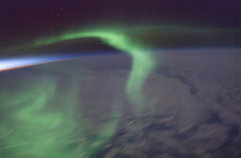 50. Sunset Colors on the Left (West) and the Delicate Green Aurora Australis Gracefully Swirling  Above Earth's Night Side As Seen From the International Space Station (Expedition 6) on February 16, 2003. Photo Credit: ISS006-E-28961, Sunset colors to the west, Earth's night side, Aurora Australis, International Space Station (Expedition Six); Image Science and Analysis Laboratory, NASA-Johnson Space Center. 'Astronaut Photography of Earth - Display Record.' <http://eol.jsc.nasa.gov/scripts/sseop/photo.pl?mission=ISS006&roll=E&frame=28961>; National Aeronautics and Space Administration (NASA, http://www.nasa.gov), Government of the United States of America (USA).