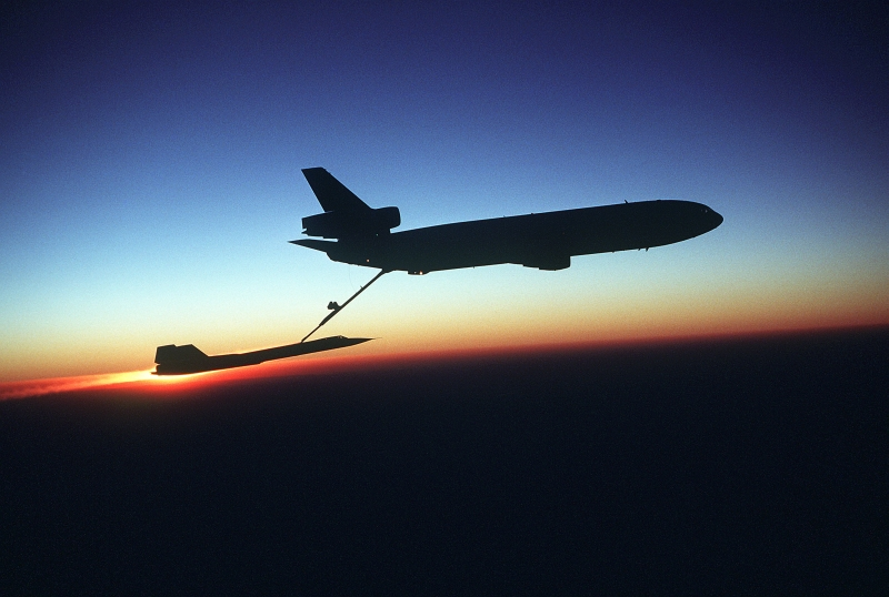 58. USAF KC-10 Extender Aircraft Refuels a USAF SR-71 Blackbird Aircraft During the Setting of the Sun, August 2, 1981, Beale Air Force Base, State of California, USA. Photo Credit: Staff Sgt. (SSGT) Bill Thompson, United States Air Force (USAF, http://www.af.mil); Defense Visual Information Center (DVIC, http://www.DoDMedia.osd.mil, DF-ST-83-03355) and United States Air Force (USAF, http://www.af.mil), United States Department of Defense (DoD, http://www.DefenseLink.mil or http://www.dod.gov), Government of the United States of America (USA).