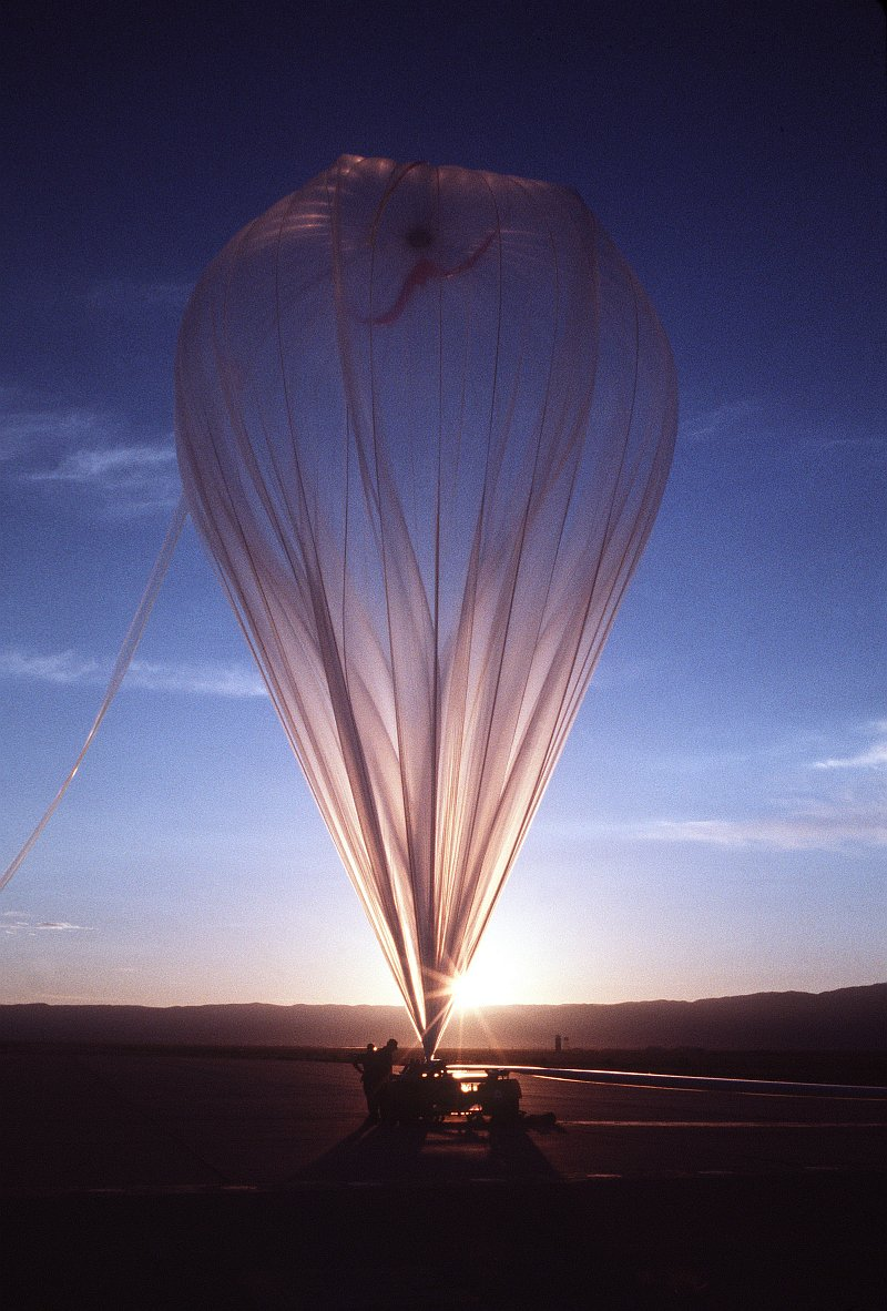 59. Preparing to Release an Enormous, Helium-Filled Balloon at Sunrise, January 1, 1979, Tularosa Basin, State of New Mexico, USA. Photo Credit: Master Sgt. (MSGT) Paul Harrington, United States Air Force (USAF, http://www.af.mil); Defense Visual Information Center (DVIC, http://www.DoDMedia.osd.mil, DFST8207594) and United States Air Force (USAF, http://www.af.mil), United States Department of Defense (DoD, http://www.DefenseLink.mil or http://www.dod.gov), Government of the United States of America (USA).