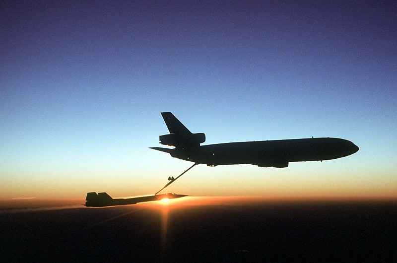 60. Another Beautiful, Golden Sunset On the Earth's Horizon as a USAF KC-10 Extender Aircraft Refuels the USAF SR-71 Blackbird Aircraft, August 2, 1981, Beale Air Force Base, State of California, USA. Photo Credit: Staff Sgt. Bill Thompson, United States Air Force (USAF, http://www.af.mil); Defense Visual Information Center (DVIC, http://www.DoDMedia.osd.mil, DFST8303356) and United States Air Force (USAF, http://www.af.mil), United States Department of Defense (DoD, http://www.DefenseLink.mil or http://www.dod.gov), Government of the United States of America (USA).