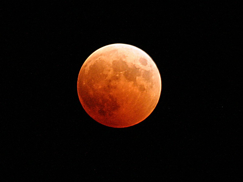 65. Rich Shades and Combinations of Orange and Red Tints From Sunrises and Sunsets On Earth Reflect Off Earth's Full Moon During the Total Lunar Eclipse, October 27, 2004, As Seen From Naval Air Station Whidbey Island, State of Washington, USA. Photo Credit: Photographer's Mate 2nd Class Scott Taylor (PH2, AW/NAC), Navy NewsStand - Eye on the Fleet Photo Gallery (http://www.news.navy.mil/view_photos.asp, 041027-N-9500T-001), United States Navy (USN, http://www.navy.mil), United States Department of Defense (DoD, http://www.DefenseLink.mil or http://www.dod.gov), Government of the United States of America (USA).