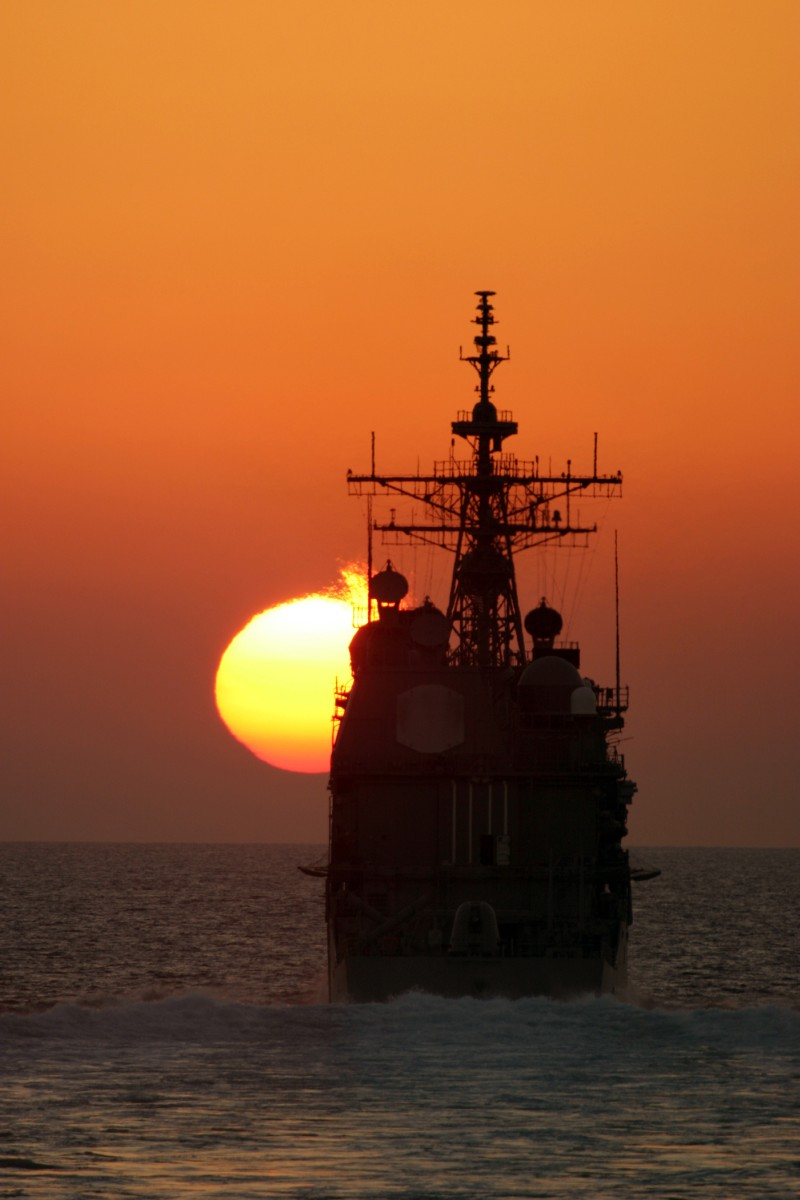 66. The Setting of the Sun Over the Arabian Gulf -- A Fiery Ball Painting the Sky Orange While Approaching the Horizon, November 9, 2004, Strait of Hormuz. Photo Credit: Cryptologic Technician 3rd Class Clayton S. Reyes, Navy NewsStand - Eye on the Fleet Photo Gallery (http://www.news.navy.mil/view_photos.asp, 041109-N-0000X-001), United States Navy (USN, http://www.navy.mil), United States Department of Defense (DoD, http://www.DefenseLink.mil or http://www.dod.gov), Government of the United States of America (USA).