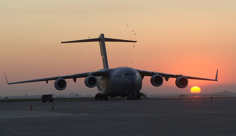 68. Birds Soar Above a USAF C-17 Globemaster III During the Rising or Setting of the Sun, November 16, 2006, Incirlik Air Base, Turkiye Cumhuriyeti - Republic of Turkey. Photo Credit: Tech. Sgt. (TSGT) Larry A. Simmons, Air Force Link - Photos (http://www.af.mil/photos, 061116-F-4692S-003, 'Active flightline'), United States Air Force (USAF, http://www.af.mil), United States Department of Defense (DoD, http://www.DefenseLink.mil or http://www.dod.gov), Government of the United States of America (USA).