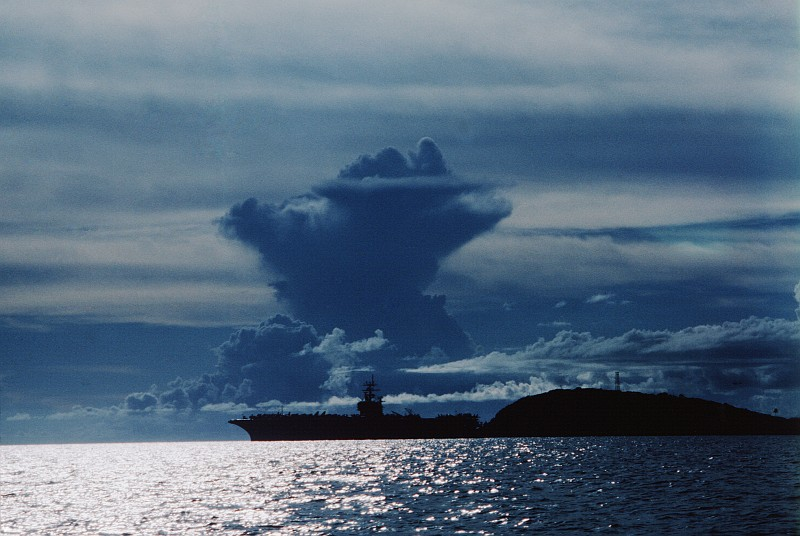 70. A Towering Cloud and the Anchored United States Navy Aircraft Carrier USS Dwight D. Eisenhower (CVN 69) at Dawn. Photo Credit: PH1 Rutschku, United States Navy (USN, http://www.navy.mil); Defense Visual Information Center (DVIC, http://www.DoDMedia.osd.mil, DNST8802028) and United States Navy (USN, http://www.navy.mil), United States Department of Defense (DoD, http://www.DefenseLink.mil or http://www.dod.gov), Government of the United States of America (USA).