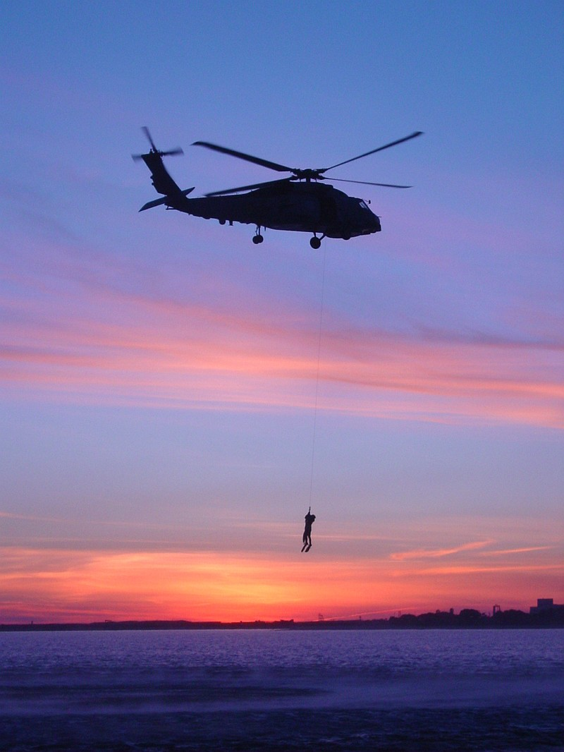 72. United States Navy SH-60B Seahawk Assigned to the 'Wolfpack' of Helicopter Anti-Submarine Squadron Light Four Five (HSL-45) Late Afternoon Training Operation at Sunset in Coronado Bay (Search And Rescue (SAR) Jump and Hoist Qualifications), San Diego, State of California, USA. Photo Credit: Lt. j.g. Jeff Valdes, Navy NewsStand - Eye on the Fleet Photo Gallery (http://www.news.navy.mil/view_photos.asp, 040212-N-0000V-001), United States Navy (USN, http://www.navy.mil), United States Department of Defense (DoD, http://www.DefenseLink.mil or http://www.dod.gov), Government of the United States of America (USA).