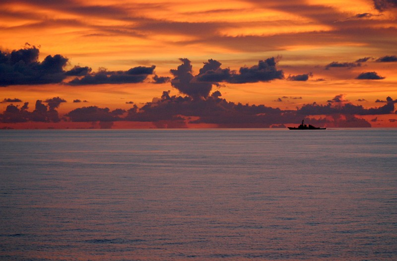 74. A Beautiful South China Sea Sunset, May 25, 2005. Photo Credit: Petty Officer 3rd Class (Journalist 3rd Class) David J. Ham, United States Navy (USN, http://www.navy.mil); 'DefendAmerica - U.S. Defense Dept. War on Terror: 05/27/2005 - Edition 5, SOUTH CHINA SEA' (http://www.DefendAmerica.mil/archive/2005-05/20050527pm2.html, http://www.DefendAmerica.mil), Photo ID: 050525-N-5663H-019, United States Department of Defense (DoD, http://www.DefenseLink.mil or http://www.dod.gov), Government of the United States of America (USA).