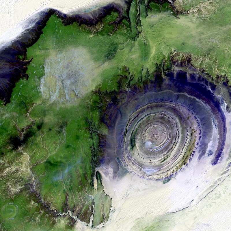 78. Richat Structure, a Spectacular Geological Formation In the Maur Adrar Desert As Seen From the NASA/USGS Landsat 7 Satellite on January 2001, Al Jumhuriyah al Islamiyah al Muritaniyah - Islamic Republic of Mauritania. Photo Credit: The NASA and USGS Landsat Project (http://landsat.gsfc.nasa.gov, http://landsat7.usgs.gov); EROS (Earth Resources Observation and Science, http://eros.usgs.gov) Image Gallery Collections (http://eros.usgs.gov/imagegallery) - Earth As Art Image Collection (http://eros.usgs.gov/imagegallery/collection.php?col=Earth+As+Art) - Richat Structure, United States Geological Survey (USGS, http://www.usgs.gov), United States Department of the Interior (http://www.doi.gov) and National Aeronautics and Space Administration (NASA, http://www.nasa.gov), Government of the United States of America (USA).
