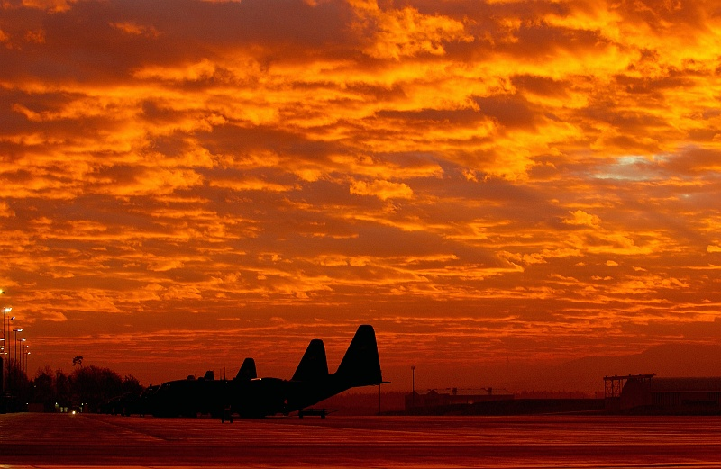 79. Fiery Sky: The Rising of the Sun on December 1, 2003, Ramstein Air Base, Landes Rheinland-Pfalz (Federal State of Rhineland-Palatinate), Bundesrepublik Deutschland - Federal Republic of Germany. Photo Credit: Tech. Sgt. (TSgt.) Justin D. Pyle, United States Air Force (USAF, http://www.af.mil); Defense Visual Information Center (DVIC, http://www.DoDMedia.osd.mil, DF-SD-06-00903 and 031201-F-6701P-001) and United States Air Force (USAF, http://www.af.mil), United States Department of Defense (DoD, http://www.DefenseLink.mil or http://www.dod.gov), Government of the United States of America (USA).