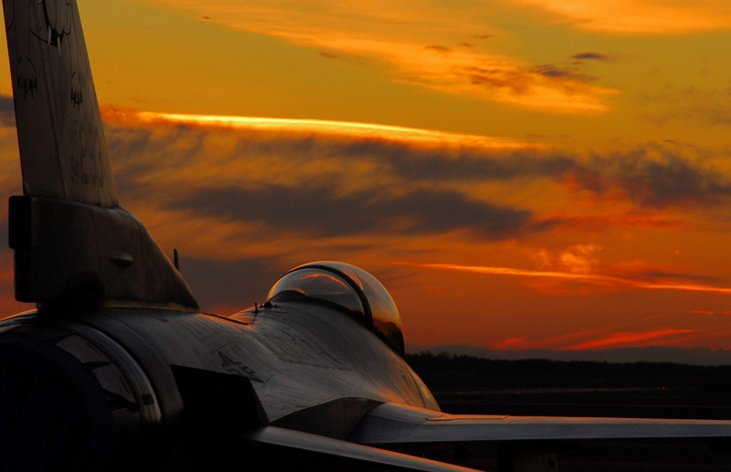 80. Very Beautiful Sunset on October 13, 2007, and a Parked USAF F-16C Fighting Falcon Fighter Jet Assigned to the 148th Fighter Wing, Minnesota Air National Guard at the Air National Guard Base, Duluth, State of Minnesota, USA. Photo Credit: Senior Airman Donald Acton, United States Air Force; Air Force Link - Week in Photos, October 19, 2007 (http://www.af.mil/weekinphotos/071019-03.html and http://www.af.mil/weekinphotos/wipgallery.asp?week=251, 071013-F-5084A-969, 'Minnesota sunset'), United States Air Force (USAF, http://www.af.mil), United States Department of Defense (DoD, http://www.DefenseLink.mil or http://www.dod.gov), Government of the United States of America (USA).