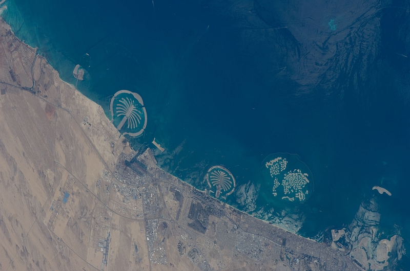 1. Palm Jebel Ali (Left), Palm Jumeirah (Center), and The World (Right), February 1, 2009 at 07:58:12 GMT, Dubai, Al Imarat al Arabiyah al Muttahidah - United Arab Emirates, As Seen From the International Space Station (Expedition 18), Latitude (LAT): 27.3, Longitude (LON): 55.3, Altitude (ALT): 189 Nautical Miles, Sun Azimuth (AZI): 168 degrees, Sun Elevation Angle (ELEV): 45 degrees. Photo Credit: NASA, International Space Station (Expedition Eighteen); ISS018-E-25364, Palm Jebel Ali and Palm Jumeirah (The Palm Islands), The World (World Islands), Dubai, United Arab Emirates; Image Science and Analysis Laboratory, NASA-Johnson Space Center. 'Astronaut Photography of Earth - Display Record.' <http://eol.jsc.nasa.gov/scripts/sseop/photo.pl?mission=ISS018&roll=E&frame=25364>; National Aeronautics and Space Administration (NASA, http://www.nasa.gov), Government of the United States of America (USA).
