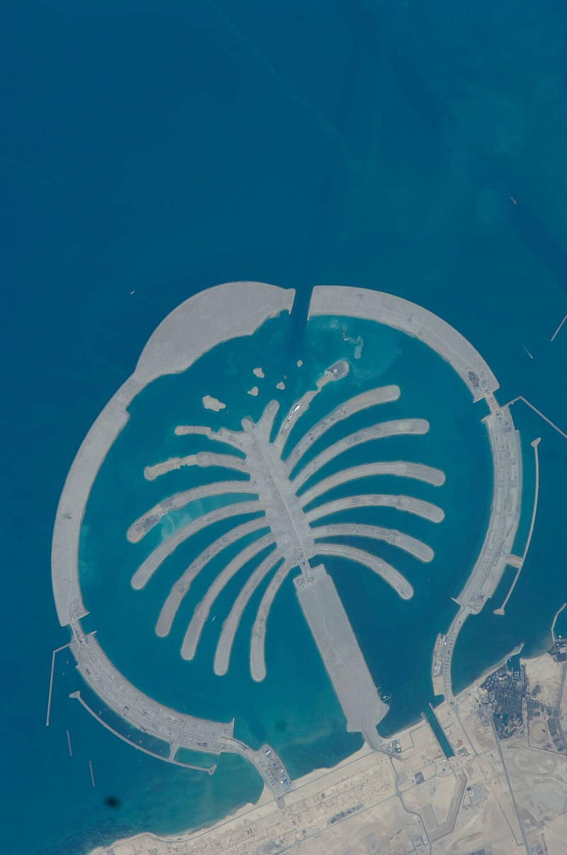 4. Palm Jebel Ali, February 1, 2009 at 07:57:21 GMT, Dubai, Al Imarat al Arabiyah al Muttahidah - United Arab Emirates, As Seen From the International Space Station (Expedition 18), Latitude (LAT): 24.9, Longitude (LON): 52.9, Altitude (ALT): 189 Nautical Miles, Sun Azimuth (AZI): 164 degrees, Sun Elevation Angle (ELEV): 47 degrees. Photo Credit: NASA, International Space Station (Expedition Eighteen); ISS018-E-26059, Palm Jebel Ali (The Palm Islands), Dubai, United Arab Emirates; Image Science and Analysis Laboratory, NASA-Johnson Space Center. 'Astronaut Photography of Earth - Display Record.' <http://eol.jsc.nasa.gov/scripts/sseop/photo.pl?mission=ISS018&roll=E&frame=26059>; National Aeronautics and Space Administration (NASA, http://www.nasa.gov), Government of the United States of America (USA).