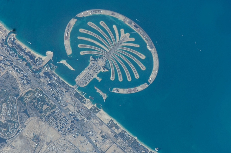 3. Palm Jumeirah, February 1, 2009 at 07:57:26 GMT, Dubai, Al Imarat al Arabiyah al Muttahidah - United Arab Emirates, As Seen From the International Space Station (Expedition 18), Latitude (LAT): 25.1, Longitude (LON): 53.1, Altitude (ALT): 189 Nautical Miles, Sun Azimuth (AZI): 165 degrees, Sun Elevation Angle (ELEV): 47 degrees. Photo Credit: NASA, International Space Station (Expedition Eighteen); ISS018-E-26061, Palm Jumeirah (The Palm Islands), Dubai, United Arab Emirates; Image Science and Analysis Laboratory, NASA-Johnson Space Center. 'Astronaut Photography of Earth - Display Record.' <http://eol.jsc.nasa.gov/scripts/sseop/photo.pl?mission=ISS018&roll=E&frame=26061>; National Aeronautics and Space Administration (NASA, http://www.nasa.gov), Government of the United States of America (USA).