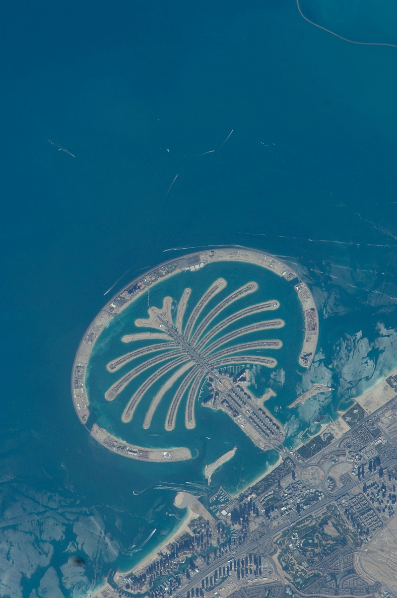6. Palm Jumeirah, February 1, 2009 at 07:57:48 GMT, Dubai, Al Imarat al Arabiyah al Muttahidah - United Arab Emirates, As Seen From the International Space Station (Expedition 18), Latitude (LAT): 26.2, Longitude (LON): 54.1, Altitude (ALT): 189 Nautical Miles, Sun Azimuth (AZI): 166 degrees, Sun Elevation Angle (ELEV): 46 degrees. Photo Credit: NASA, International Space Station (Expedition Eighteen); ISS018-E-26072, Palm Jumeirah (The Palm Islands), Dubai, United Arab Emirates; Image Science and Analysis Laboratory, NASA-Johnson Space Center. 'Astronaut Photography of Earth - Display Record.' <http://eol.jsc.nasa.gov/scripts/sseop/photo.pl?mission=ISS018&roll=E&frame=26072>; National Aeronautics and Space Administration (NASA, http://www.nasa.gov), Government of the United States of America (USA).