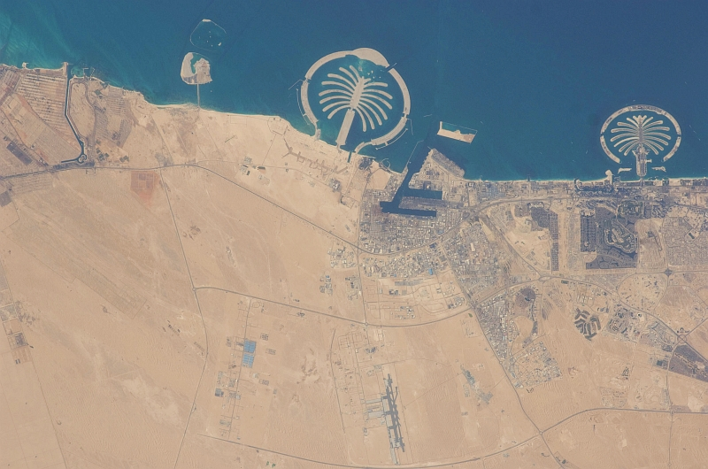 5. Palm Jebel Ali (Left) and Palm Jumeirah (Right), March 20, 2009 at 12:39:57 GMT, Dubai, Al Imarat al Arabiyah al Muttahidah - United Arab Emirates, As Seen From the International Space Station (Expedition 18), Latitude (LAT): 25.5, Longitude (LON): 55.1, Altitude (ALT): 191 Nautical Miles, Sun Azimuth (AZI): 258 degrees, Sun Elevation Angle (ELEV): 24 degrees. Photo Credit: NASA, International Space Station (Expedition Eighteen); ISS018-E-41938, Palm Jebel Ali and Palm Jumeirah (The Palm Islands), Dubai, United Arab Emirates; Image Science and Analysis Laboratory, NASA-Johnson Space Center. 'Astronaut Photography of Earth - Display Record.' <http://eol.jsc.nasa.gov/scripts/sseop/photo.pl?mission=ISS018&roll=E&frame=41938>; National Aeronautics and Space Administration (NASA, http://www.nasa.gov), Government of the United States of America (USA).