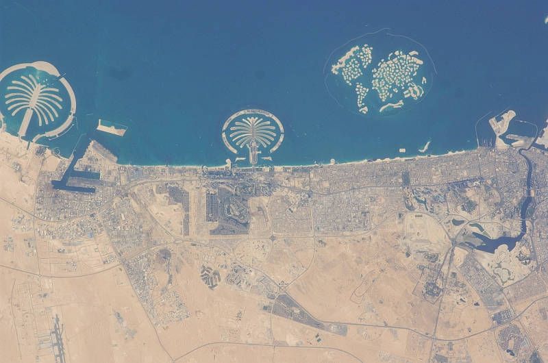 8. Palm Jebel Ali (Left), Palm Jumeirah (Center), and The World (Right), March 20, 2009 at 12:39:58 GMT, Dubai, Al Imarat al Arabiyah al Muttahidah - United Arab Emirates. As Seen From the International Space Station (Expedition 18), Latitude (LAT): 25.5, Longitude (LON): 55.1, Altitude (ALT): 191 Nautical Miles, Sun Azimuth (AZI): 258 degrees, Sun Elevation Angle (ELEV): 24 degrees. Photo Credit: NASA, International Space Station (Expedition Eighteen); ISS018-E-41939, Palm Jebel Ali and Palm Jumeirah (The Palm Islands), The World (World Islands), Dubai, United Arab Emirates; Image Science and Analysis Laboratory, NASA-Johnson Space Center. 'Astronaut Photography of Earth - Display Record.' <http://eol.jsc.nasa.gov/scripts/sseop/photo.pl?mission=ISS018&roll=E&frame=41939>; National Aeronautics and Space Administration (NASA, http://www.nasa.gov), Government of the United States of America (USA).