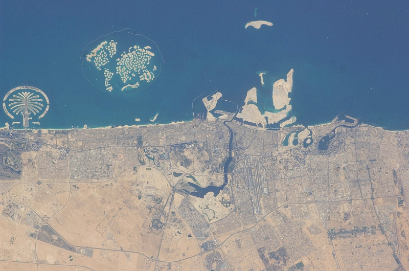 7. Palm Jumeirah (Left) and The World (Right), March 20, 2009 at 12:39:59 GMT, Dubai, Al Imarat al Arabiyah al Muttahidah - United Arab Emirates, As Seen From the International Space Station (Expedition 18), Latitude (LAT): 25.6, Longitude (LON): 55.2, Altitude (ALT): 191 Nautical Miles, Sun Azimuth (AZI): 258 degrees, Sun Elevation Angle (ELEV): 24 degrees. Photo Credit: NASA, International Space Station (Expedition Eighteen); ISS018-E-41940, Palm Jumeirah (The Palm Islands), The World (World Islands); Image Science and Analysis Laboratory, NASA-Johnson Space Center. 'Astronaut Photography of Earth - Display Record.' <http://eol.jsc.nasa.gov/scripts/sseop/photo.pl?mission=ISS018&roll=E&frame=41940>; National Aeronautics and Space Administration (NASA, http://www.nasa.gov), Government of the United States of America (USA).