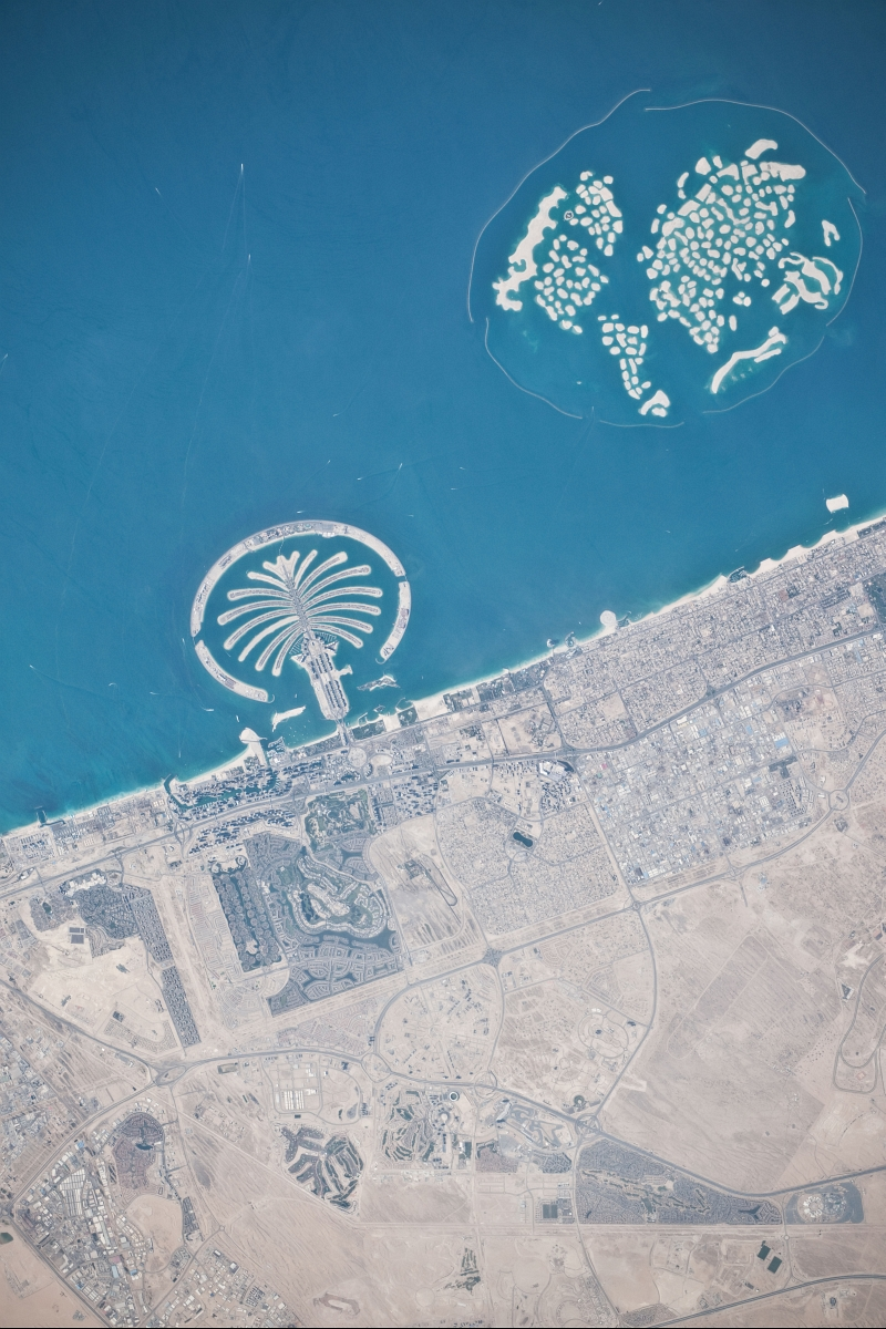 11. Palm Jumeirah and The World, March 13, 2010 at 10:32:48 GMT, Dubai, Al Imarat al Arabiyah al Muttahidah - United Arab Emirates, As Seen From the International Space Station (Expedition 22), Latitude (LAT): 26.2, Longitude (LON): 55.8, Altitude (ALT): 183 Nautical Miles, Sun Azimuth (AZI): 231 degrees, Sun Elevation Angle (ELEV): 48 degrees. Photo Credit: NASA, International Space Station (Expedition Twenty-Two), ISS022-E-101580; Image Science and Analysis Laboratory, NASA-Johnson Space Center. 'Astronaut Photography of Earth - Display Record.' <http://eol.jsc.nasa.gov/scripts/sseop/photo.pl?mission=ISS022&roll=E&frame=101578>; National Aeronautics and Space Administration (NASA, http://www.nasa.gov), Government of the United States of America (USA).