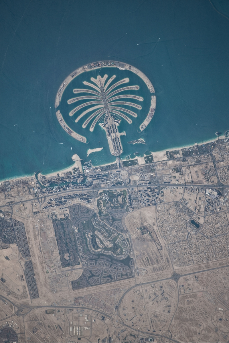 10. Palm Jumeirah, March 13, 2010 at 10:32:46 GMT, Dubai, Al Imarat al Arabiyah al Muttahidah - United Arab Emirates, As Seen From the International Space Station (Expedition 22), Latitude (LAT): 26.6, Longitude (LON): 56.1, Altitude (ALT): 183 Nautical Miles, Sun Azimuth (AZI): 231 degrees, Sun Elevation Angle (ELEV): 47 degrees. Photo Credit: NASA, International Space Station (Expedition Twenty-Two), ISS022-E-101580; Image Science and Analysis Laboratory, NASA-Johnson Space Center. 'Astronaut Photography of Earth - Display Record.' <http://eol.jsc.nasa.gov/scripts/sseop/photo.pl?mission=ISS022&roll=E&frame=101580>; National Aeronautics and Space Administration (NASA, http://www.nasa.gov), Government of the United States of America (USA).