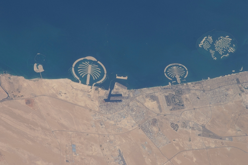 12. Palm Jebel Ali (Left), Palm Jumeirah (Center), and The World (Right), September 13, 2010 at 07:27:42 GMT, Dubai, Al Imarat al Arabiyah al Muttahidah - United Arab Emirates, As Seen From the International Space Station (Expedition 24), Latitude (LAT): 23.0 Longitude (LON): 55.1, Altitude (ALT): 187 Nautical Miles, Sun Azimuth (AZI): 147 degrees, Sun Elevation Angle (ELEV): 68 degrees. Photo Credit: NASA, International Space Station (Expedition Twenty-Four); ISS024-E-14312, Palm Jebel Ali and Palm Jumeirah (The Palm Islands), The World (World Islands), Dubai, United Arab Emirates; Image Science and Analysis Laboratory, NASA-Johnson Space Center. 'Astronaut Photography of Earth - Display Record.' <ISS024-E-14312>; National Aeronautics and Space Administration (NASA, http://www.nasa.gov), Government of the United States of America (USA).