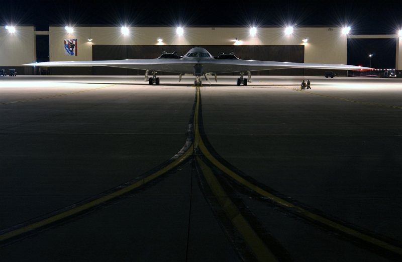 46. Engines Running, A U.S. Air Force B-2 Spirit Stealth Bomber Sits On the Ramp Before Going On A Combat Mission During Operation Iraqi Freedom, March 21, 2003, Whiteman Air Force Base, State of Missouri, USA. Photo Credit: Tech. Sgt. Michael R. Nixon, United States Air Force; Defense Visual Information (DVI, http://www.DefenseImagery.mil, 030321-F-WM157-009, DFSD0501354, and DF-SD-05-01354) and United States Air Force (USAF, http://www.af.mil), United States Department of Defense (DoD, http://www.DefenseLink.mil or http://www.dod.gov), Government of the United States of America (USA).
