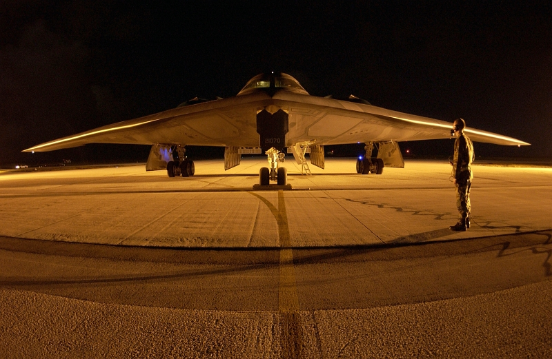 44. A U.S. Air Force Crew Chief Watches and Guards His U.S. Air Force B-2 Spirit Stealth Bomber While Air Crews (Pilots) Switch Shifts at Night, February 5, 2004, Andersen Air Force Base, Territory of Guam, USA. Photo Credit: Staff Sgt. Bennie J. Davis III, United States Air Force; Defense Visual Information (DVI, http://www.DefenseImagery.mil, 040205-F-VY627-233, 040205-F-5040D-233, DFSD0601970, and DF-SD-06-01970) and United States Air Force (USAF, http://www.af.mil), United States Department of Defense (DoD, http://www.DefenseLink.mil or http://www.dod.gov), Government of the United States of America (USA).