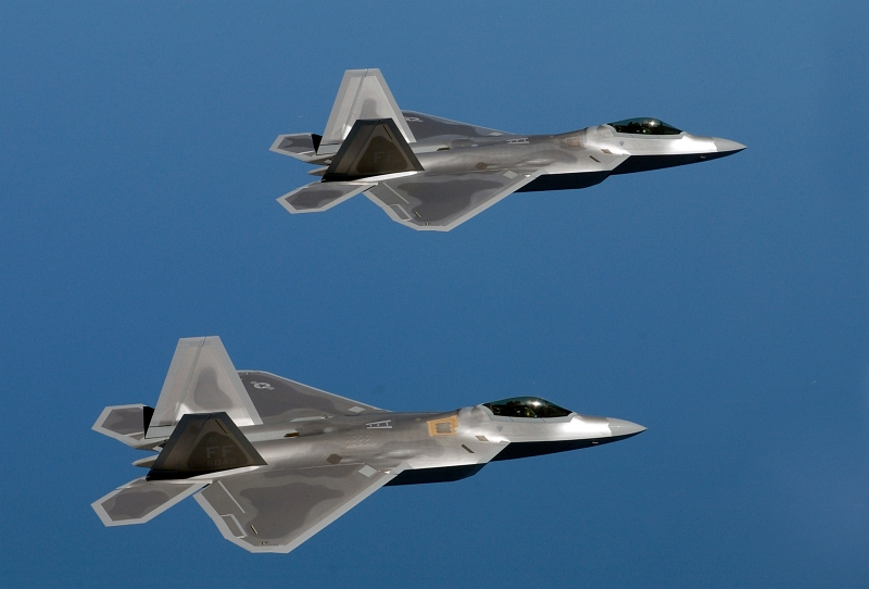 58. Two U.S. Air Force F-22A (F/A-22) Raptors Fly Over Langley Air Force Base, August 12, 2005, Commonwealth of Virginia, USA. Photo Credit: Tech. Sgt. Ben Bloker, United States Air Force; 050812-F-2295B-057; United States Air Force (USAF, http://www.af.mil), United States Department of Defense (DoD, http://www.DefenseLink.mil or http://www.dod.gov), Government of the United States of America (USA).
