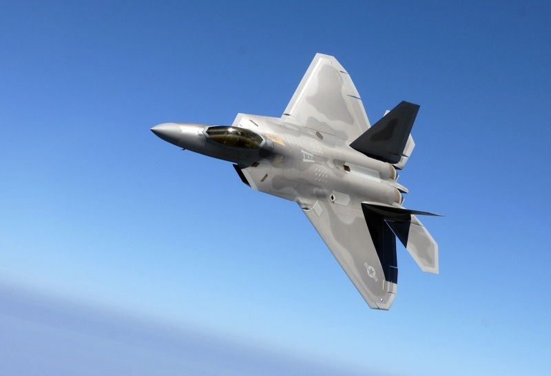 "31. Backdropped By A Blue Sky, the U.S. Air Force F-22A Raptor Stealth Fighter Jet Banks During A Training Sortie, August 12, 2005, Langley Air Force Base, Commonwealth of Virginia, USA. Photo Credit: Tech. Sgt. Ben Bloker, Air Force Link - Photos (http://www.af.mil/photos, 050812-F-2295B-147, ""Raptor presence""), United States Air Force (USAF, http://www.af.mil), United States Department of Defense (DoD, http://www.DefenseLink.mil or http://www.dod.gov), Government of the United States of America (USA)."