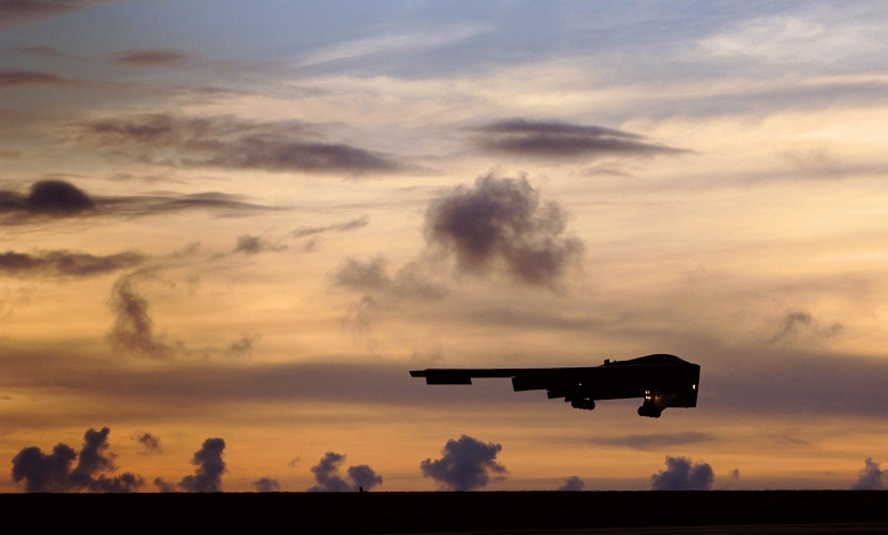 16. A U.S. Air Force B-2 Spirit Stealth Bomber Landing at Andersen Air Force Base (AFB) After A Long-Range Training Sortie Between Alaska and Guam, August 19, 2005, Territory of Guam, USA. Photo Credit: Staff Sgt. Bennie J. Davis III, United States Air Force; Defense Visual Information (DVI, http://www.DefenseImagery.mil, 050819-F-5040D-363 and DF-SD-08-20976) and United States Air Force (USAF, http://www.af.mil), United States Department of Defense (DoD, http://www.DefenseLink.mil or http://www.dod.gov), Government of the United States of America (USA).