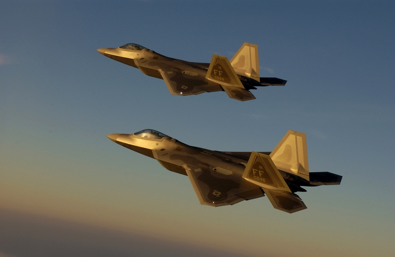 17. Bathed In Golden Sunlight, Two U.S. Air Force F-22A Raptor Fighter Jets Fly Over Langley Air Force Base, September 9, 2005, Commonwealth of Virginia, USA. Photo Credit: Technical Sgt. Ben Bloker, Air Force Link - Photos (http://www.af.mil/photos, 050909-F-2295B-095), United States Air Force (USAF, http://www.af.mil), United States Department of Defense (DoD, http://www.DefenseLink.mil or http://www.dod.gov), Government of the United States of America (USA).
